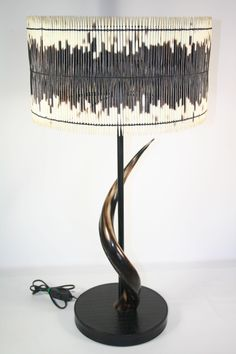 Porcupine Quill Lampshade with polished Kudu Horn and leather base. Available at http://phasesafrica.com