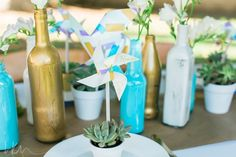 DIY styled shoot using Dollar Store items -- pinwheels and painted bottle centerpieces by Pop The Champagne Events!