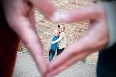 Divine Image Photography - husband and wife's hand make a heart over their kids. Cute family photo idea! :)