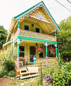 Soft pastel gingerbread trims this Fair Avenue home. Mobile Home Exteriors, House Exteriors, Cottage Design, House Design, Dreamland, Key West Style, Red Houses, Gnome House, House On The Rock