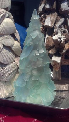 Sea glass Christmas Tree - sea glass - hot glue - cardboard cone Sand 'N Sea Properties LLC, Galveston, TX Sea Glass Crafts, Sea Glass Art, Seashell Crafts, Beach Crafts, Coastal Christmas Decor, Nautical Christmas, Christmas Decorations, Purple Christmas, Table Decorations