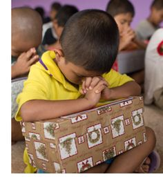 Call to Prayer - Join with people around the world and bless a child with a shoebox and sign up to cover the volunteer packers, deliverers, and shoe box recipients in prayer.