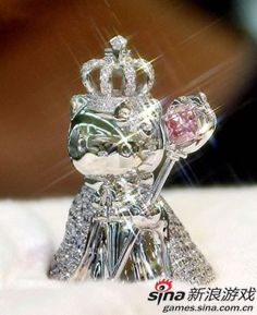 # THE WORLD'S MOST EXPENSIVE HELLO KITTY ITEM, priced at 10 million yen ($91,900), is displayed at Mitsukoshi department store as part of a celebration to mark Hello Kitty's 30th birthday. The platinum made Hello Kitty, 41mm tall and weighing 75g, wears a cloak studded with 205 pieces 4.1 ct and a mace with 0.753 ct pink colored diamond.
