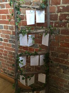 Vintage ladder and ivy seating plan at Wasing Park
