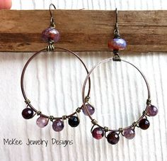 Wire wrapped purple gemstone and copper hoop earrings.