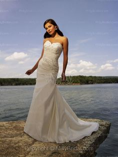 A-Line Sweetheart Embroidery Beading Taffeta Chapel Train Wedding Dress at Millybridal.com