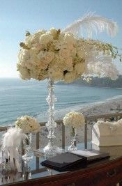 Nothing says the roaring 20s quite like tall floral arrangements and feathers! #gatsbywedding #greatgatsby #weddings