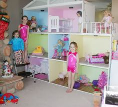 """American Girl Dollhouse...ladder required!  It has a living room, kitchen, bathroom, 4 bedrooms, and a porch!  8' long, 7'9"""" tall, 2' deep."""