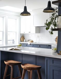 A Century-Old Home Comes to Life With a Mashup of Modern Ideas You'll Want to Copy Kitchen: White uppers, deep blue/navy lowers, grey/white quartz countertop Navy Blue Kitchen Cabinets, Blue Kitchen Island, Grey Cabinets, Quartz Kitchen Countertops, Kitchen Countertop Materials, Grey Countertops, Kitchen Interior, New Kitchen, Kitchen Ideas