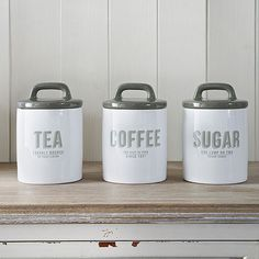 Charming retro design white and grey enamel ceramic tea coffee and sugar canisters Ceramic push on lids with rubber seals All our products come with Tea Coffee Sugar Canisters, Coffee Jars, Coffee Canister, Tea Canisters, Kitchen Jars, Kitchen Ideas, Kitchen Decor, Kitchen Cabinets, Sugar Container