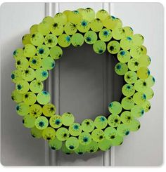 Scary Halloween wreath--thinking that you could use anything that glows in the dark--those little spider rings or plastic ghosts...and find them cheaper than the ones she lists here...