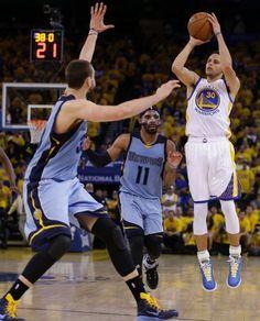 Grizzlies vs. Warriors - Golden State Warriors' Stephen Curry, right, shoots over Memphis Grizzlies' MARC GASOL