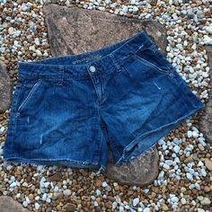 """American Eagle Cut Off Jean Shorts American Eagle Cut Off Jean Shorts. Classic 5 pocket style. Zip fly with button waistband. Medium wash distressed denim. 23"""" leg opening with 4"""" inseam. Material: 100% Cotton. Excellent used condition. Size 4. Trades. American Eagle Outfitters Shorts Jean Shorts"""