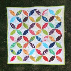 Orange Peel Mini Quilt from A Little Bit Biased + a link to her Freezer Paper Applique tutorial.
