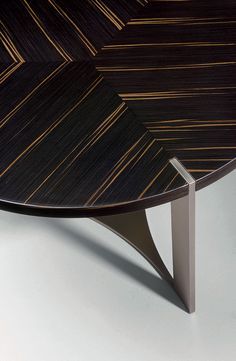 Tolomeo coffee table detail by Fendi Casa. Perfect meeting of metal and wood in one smooth surface. Luxury Living Group