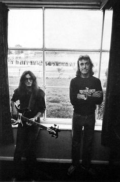 Geddy Lee and Neil Peart. Rush. Read Neil's shirt.  Yup. I took drum lessons there.