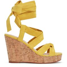 Get into the spring spirit with the cork trend. This JustFab wedge features soft, feminine ankle ties that can be worn up the leg for a more dramatic look. S…
