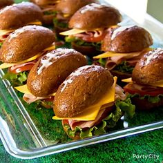 "The key to making these ""football"" sandwiches? Use cream cheese for the stitching on the top. :)"