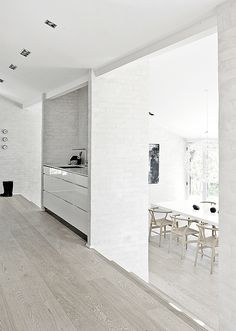 white brick walls, high gloss kitchen, grey floors. So clean, so beautiful. I would have some pop of color somehow though or else it would feel like a psych ward