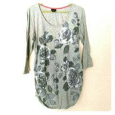 Floral 3/4 sleeve maternity top In excellent condition, only worn a couple times. Very soft oh baby by motherhood shirt. Has a gray flower print with some silver glitter accent. 3/4 sleeve. Longer fit so it always covers the belly! Motherhood Maternity Tops Tees - Long Sleeve