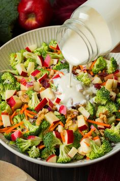 Broccoli Apple Salad with a creamy dressing getting poured over the top Slaw Recipes, Healthy Salad Recipes, Healthy Snacks, Vegetarian Recipes, Healthy Eating, Cooking Recipes, Delicious Recipes, Vegetarian Salad, Broccoli Cauliflower Salad