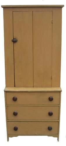Early 19th century Stepback Cupboard over three drawers, in old mustard paint