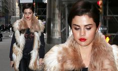 Selena Gomez looks downcast wearing furry coat on a walk in New York