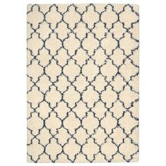 Rugs - Amore Shaggy Rug in Ivory White and Blue - Hutsly. A rug which shaggyness simply begs to be touched, the Amore rug in Ivory White and Blue is also available in other colours and features a diamond pattern reminiscent of Moroccan designs : texture and colour meet style and substance! Perfect to spice up any decor!