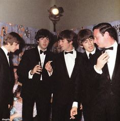 The Beatles and Brian Epstein at the premiere of 'A Hard Day's Night', London Pavilion, 6 Jul. 1964.