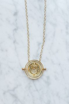 """""""The Time Turner"""" necklace, it's the one Hermione Granger wore in the """"Harry Potter and The Chamber Of Secrets"""" movie"""