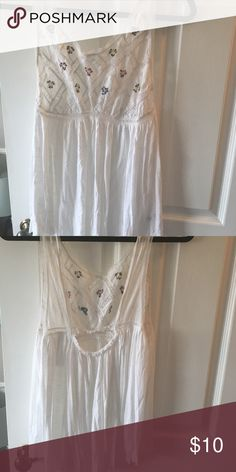 FREE PEOPLE open back lace top Summery free people top with lace and floral detail and very open back. Kind of sheer so it's best wth something under or over it. Free People Tops Blouses