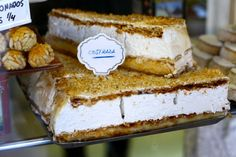 A delicious Spanish pastry called Costrada: Puff pastry, soft meringue filling, pastry cream, and candied almonds. Amazing!