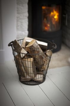 If you have an open fire in your home, don't keep your wood outside - a wire basket on your hearth not only looks great, but also fills the room with the scent of pine and the outdoors! Wood Basket, Metal Baskets, Rattan Basket, Storage Baskets, Firewood Storage, Wire Storage, Storage Ideas, Large Wire Basket, Black Wire Basket