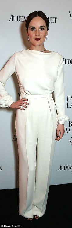 All white on the night: Ellie Goulding kept her look classy and simple to pick up the top Musician prize, but Michelle Dockery unfortunately opted for a similar white look to collect the Television Icon awards