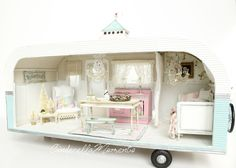 """Wish You Were Here"" is a trailer dollhouse I made from scratch. It's 1/12 scale(1 inch scale). Overall length is 22"" with the hitch post(t..."