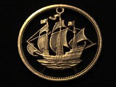 Bronze Half Penny – Great Britain, 1959. Cut-coin jewelry art by Rob Johnson, on Etsy.