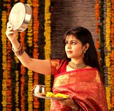 Karwa Chauth is a ritual of fasting observed by married Hindu women seeking the well-being and prosperity of their husbands. Simplicity Is Beauty, Bengali Bridal Makeup, Best Designer Dresses, We Are Festival, Beauty Forever, Girl Photography Poses, Wedding Photography, Indian Festivals, Married Woman