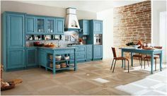 A classic kitchen in solid wood, featuring light blue decapé. Solid Wood, Kitchen Cabinets, Table, Furniture, Home Decor, Light Blue, Kitchens, Home, Trendy Tree