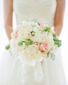 A romantic bouquet of peonies, roses and succulents.