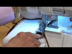 * BabyLock Serger Workshop with Pam Mahshie and Nancy Zieman -- demo of wave stitch on edge of zipper tape, which will be used as an exposed zipper in a garment.