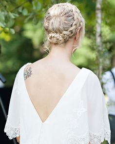 milkmaid braid by her hairstylist Diana Streany. A golden mesh headband from Anthropologie that was embellished and restructured with porcelain roses and seed pearls by a bridesmaid was incorporated into the 'do.