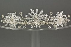 Snowflake Crystal and Diamante Wedding Tiara. The Snowflake wedding tiara is a stunning mid winter inspired wedding tiara design featuring three handcrafted swarovski crystal snowflakes surrounded by more swarovski crystals and diamante. Available in gold or silver and a fabulous range of crystal colours.