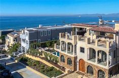 This spacious beach estate is located on 2.5 walkstreet lots with stunning panoramic ocean and white water views. The warm and inviting home was designed...