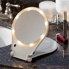 Solutions - 10X Lighted Travel Mirror