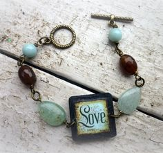 LOVE in a 1inch square charm and brown agate green by BeadMuse