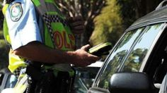 A female driver in Melbourne has had her licence suspended after she allegedly recorded more than five times the legal alcohol limit after losing control and crashing through two fences.
