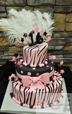 This Sweet 16 Birthday Cake has hand painted zebra print on this 3 tiered fondant topsy -turvy cake