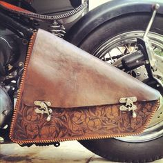 I like these clasps custom handmade leather chopper saddle bag - hand tooled with leather lacing