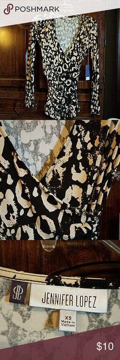 "JENNIFER LOPEZ BLOUSE Long sleeve top elastic gathering on the sides. Never worn.  Approximate measurements shoulder to bottom  26"", armpit to armpit 15"".  95% Polyester,  5% Spandex. Jennifer Lopez Tops Blouses"