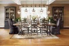 great dining chairs for formal. love the mix of upholstered end chairs and wood side chairs -- refinishing top of table white, side chairs could be white too